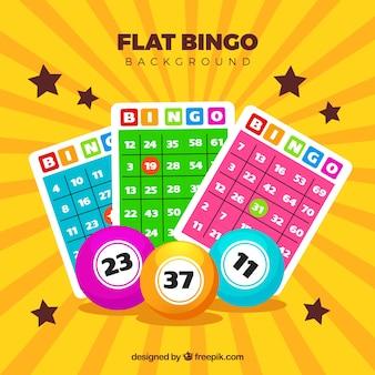 Fondo amarillo con bolas de bingo y papeletas