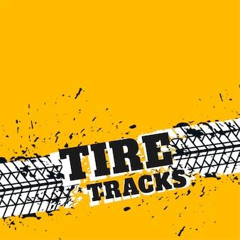 Fondo amarillo con marcas de neumáticos grunge