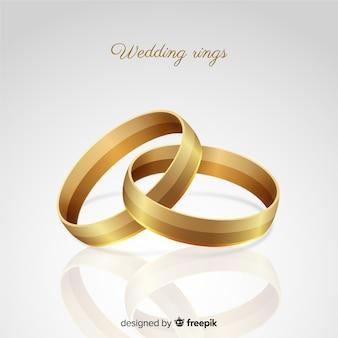 Fondo anillos de boda dorados realistas