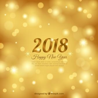 Fondo de año nuevo 2018 borroso y dorado