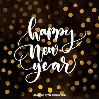 Fondo de año nuevo en acuarela con letras caligráficas blancas