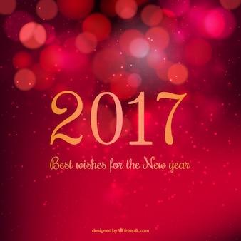Fondo de año nuevo rojo en estilo bokeh