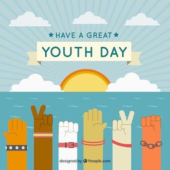 Fondo de atardecer con manos celebrando el día de la juventud