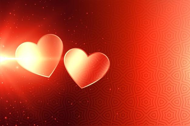 Fondo atractivo de dos corazones brillantes del día de san valentín