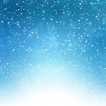 Fondo azul bokeh de copos de nieve