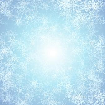 Fondo azul con copos de nieve blancos