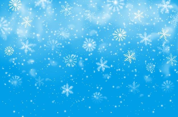 Fondo azul de los copos de nieve de navidad.