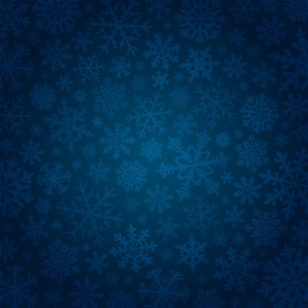 Fondo azul con copos de nieve