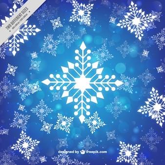 Fondo azul de copos de nieve