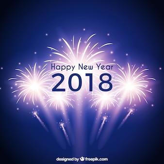Fondo azul de año nuevo con fuegos artificiales