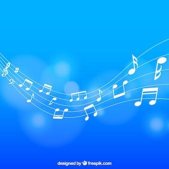 Fondo azul desenfocado de pentagrama con notas musicales