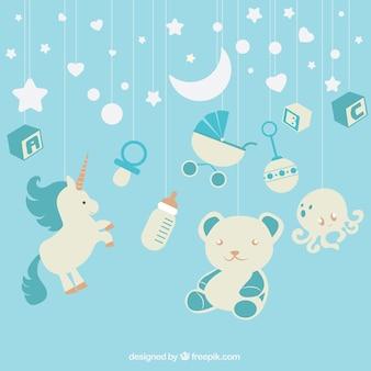 Fondo azul con elementos de bebé colgando