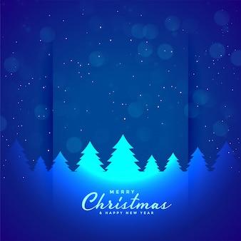 Fondo azul feliz del árbol de navidad y de los copos de nieve