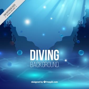 Fondo azul de submarinismo con algas
