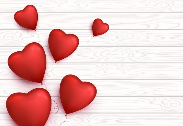 Fondo de banner de día de san valentín con globos en forma de corazón.
