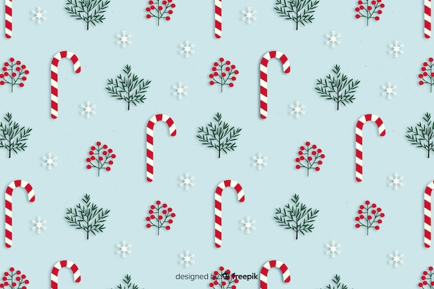 Fondo de bastones de caramelo de navidad en diseño plano