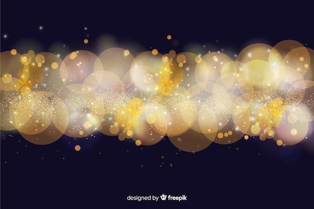 Fondo bokeh con partículas doradas
