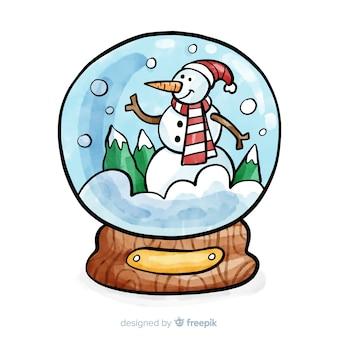 Fondo con bola de nieve de navidad en acuarela vector gratuito
