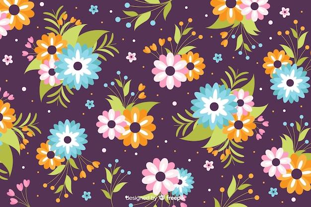 Fondo bonito de flores en diseño plano