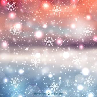 Fondo borroso de navidad con copos de nieve