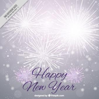 Fondo brillante de año nuevo con fuegos artificiales