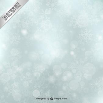 Fondo brillantes de copos navideños de nieve