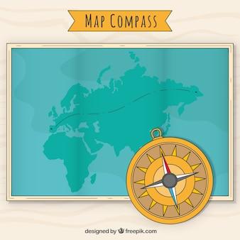 Fondo de brújula sobre mapa del mundo