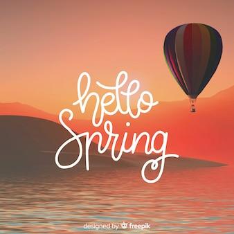 Fondo caligráfico de hello spring con fotografía