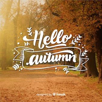 Fondo caligráfico de hola otoño con foto