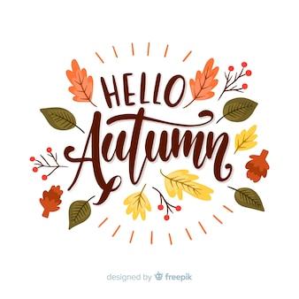 Fondo caligráfico de hola otoño con hojas