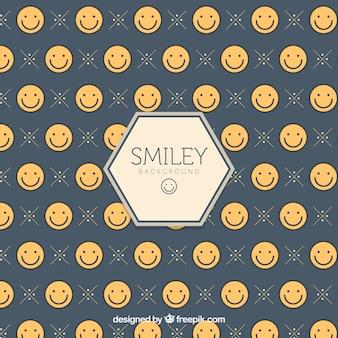 Fondo con caritas sonrientes planas
