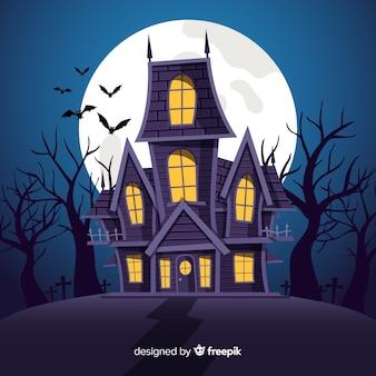 Fondo con casa encantada de halloween en diseño plano