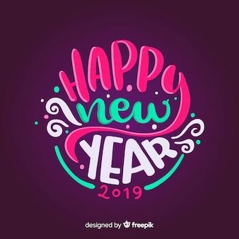 Fondo colorido de feliz año nuevo 2019 con lettering