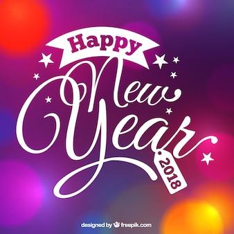 Fondo con letras de año nuevo con efecto bokeh