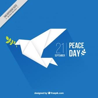 Fondo con una paloma de la paz de origami