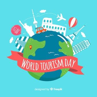 Fondo concepto día mundial del turismo con bola del mundo y monumentos