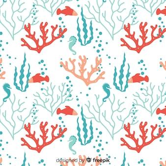 Fondo coral con animales marinos dibujado a mano