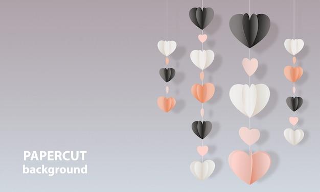 Fondo con los corazones de la forma del corte del papel del color.