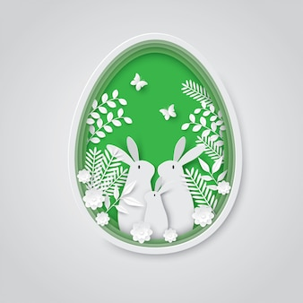 Fondo de corte de papel de vacaciones de pascua, familia de conejo en huevo.
