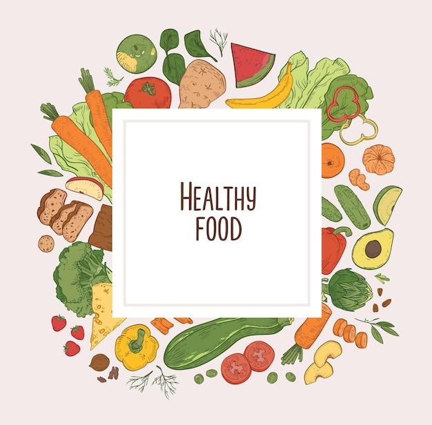 Fondo cuadrado con marco compuesto por verduras frescas, frutas, bayas y productos dietéticos orgánicos