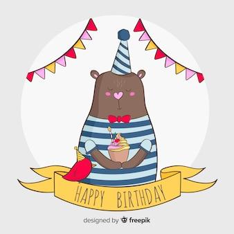 Fondo cumpleaños oso con cupcake dibujado a mano