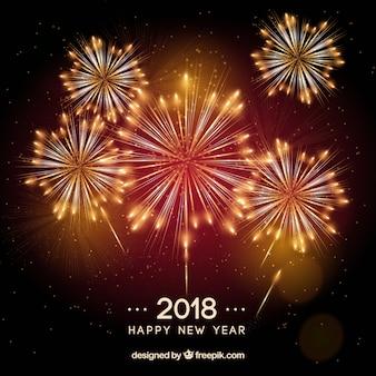 Fondo de año nuevo 2018 con fuegos artificiales en rojo