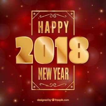 Fondo de año nuevo con letras doradas y efecto bokeh
