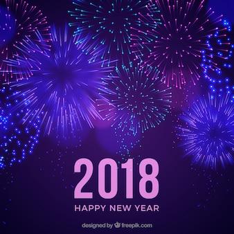 Fondo de año nuevo púrpura con fuegos artificiales
