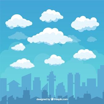 Fondo de cielo con nubes y ciudad en estilo plano