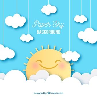 Fondo de cielo con nubes y lindo sol en textura de papel