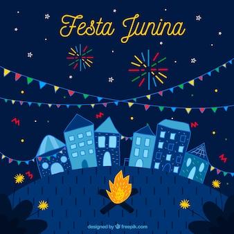Fondo de fiesta junina con pueblo y fuegos artificiales