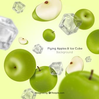Fondo de manzanas  y cubos de hielo volando en estilo realista