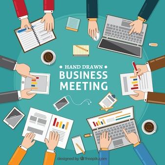 Fondo de reunión de negocios con documentos y portátiles