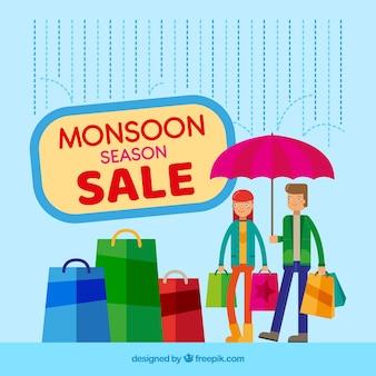 Fondo de venta de temporada de monzón con bolsas de compra